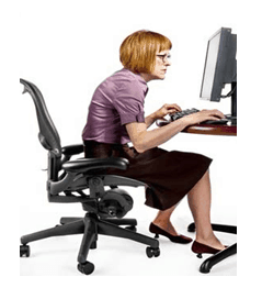 10. Slouching forward while sitting